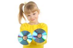 Muchacha con Cd Imágenes de archivo libres de regalías