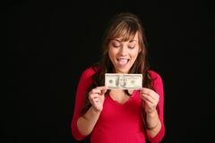 Muchacha con cientos cuentas de dólar foto de archivo libre de regalías