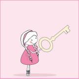 Muchacha con clave Foto de archivo libre de regalías