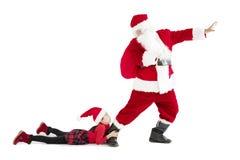 muchacha con concepto de la Feliz Navidad de Papá Noel imagen de archivo libre de regalías