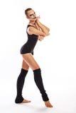 Muchacha con danzas del maquillaje del payaso Foto de archivo