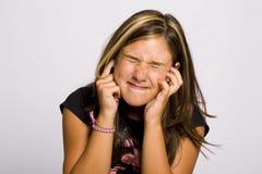 Muchacha con dolor de oído Imágenes de archivo libres de regalías