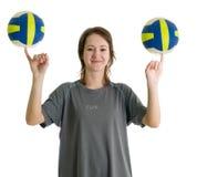 Muchacha con dos bolas del voleibol Fotos de archivo