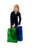 Muchacha con dos bolsos de compras. Fotos de archivo libres de regalías