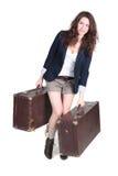 Muchacha con dos cajas pesadas Foto de archivo libre de regalías