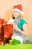 Muchacha con dos conejos del animal doméstico Imagen de archivo libre de regalías