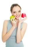 Muchacha con dos manzanas Fotografía de archivo libre de regalías