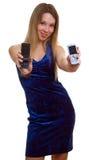 Muchacha con dos teléfonos móviles Fotografía de archivo libre de regalías