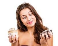 Muchacha con dos tortas Imagen de archivo libre de regalías