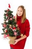 Muchacha con el árbol de navidad a disposición Fotos de archivo