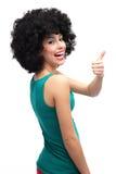Muchacha con el afro que muestra los pulgares para arriba Fotografía de archivo libre de regalías