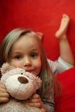 Muchacha con el animal relleno Imagen de archivo libre de regalías
