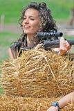 Muchacha con el arma Fotos de archivo