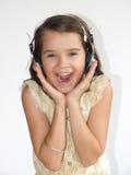 Muchacha con el auricular Foto de archivo