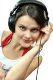 Muchacha con el auricular Fotos de archivo