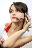 Muchacha con el auricular Imagen de archivo libre de regalías