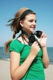 Muchacha con el auricular Fotografía de archivo