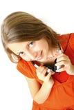 Muchacha con el auricular en manos Fotografía de archivo libre de regalías