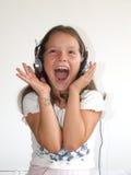 Muchacha con el auricular feliz Imagen de archivo libre de regalías
