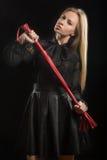 Muchacha con el azote de cuero rojo Fotografía de archivo libre de regalías