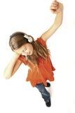 Muchacha con el baile de los auriculares Fotografía de archivo