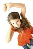 Muchacha con el baile de los auriculares   Imagen de archivo libre de regalías