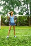 Muchacha con el balón de fútbol Foto de archivo libre de regalías