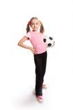 Muchacha con el balón de fútbol Imagen de archivo