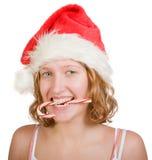 Muchacha con el bastón de caramelo rojo y blanco fotos de archivo libres de regalías
