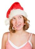 Muchacha con el bastón de caramelo rojo y blanco fotografía de archivo