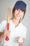 Muchacha con el bate de béisbol Fotografía de archivo libre de regalías