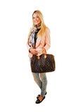 Muchacha con el bolso. Imagen de archivo libre de regalías