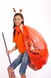 Muchacha con el bolso del césped Fotos de archivo libres de regalías