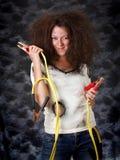 Muchacha con el cable del aumentador de presión Fotografía de archivo libre de regalías