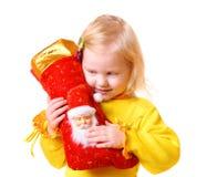 Muchacha con el calcetín de la Navidad Imagen de archivo libre de regalías