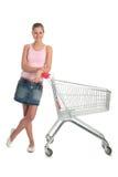 Muchacha con el carro de compras imagen de archivo libre de regalías