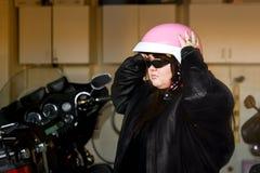 Muchacha con el casco de la motocicleta Fotografía de archivo libre de regalías