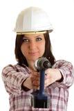 Muchacha con el casco y el taladro Foto de archivo libre de regalías
