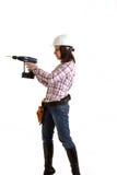 Muchacha con el casco y el taladro Imagen de archivo libre de regalías