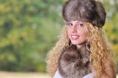 Muchacha con el casquillo de la piel Imagen de archivo libre de regalías