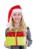 Muchacha con el casquillo y el presente de Papá Noel Imágenes de archivo libres de regalías