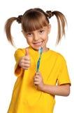 Muchacha con el cepillo de dientes Imágenes de archivo libres de regalías