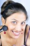 Muchacha con el cepillo del maquillaje Fotografía de archivo libre de regalías