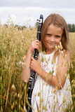 Muchacha con el clarinet Imagen de archivo