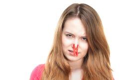 Muchacha con el clothespin en su nariz. fotografía de archivo libre de regalías