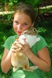 Muchacha con el conejito Imagen de archivo libre de regalías