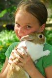 Muchacha con el conejito Fotografía de archivo libre de regalías
