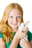 Muchacha con el conejo del animal doméstico Fotografía de archivo libre de regalías