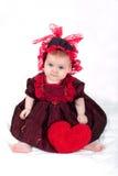 Muchacha con el corazón Fotos de archivo