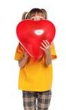 Muchacha con el corazón Fotografía de archivo libre de regalías